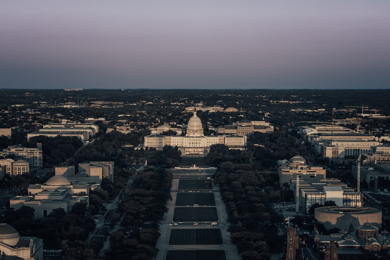 Aerial view of Capitol Building and surrounding area at dusk