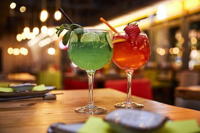 Two cocktails set on a table